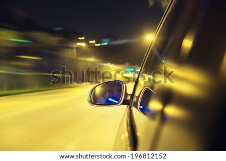 car moving fast in road - stock photo