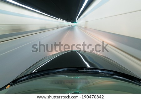 car moving fast in tunne  - stock photo