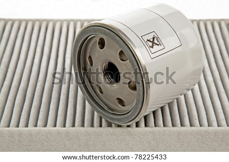 car oil filter and pollen filter - stock photo