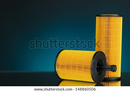 Car oil filters on dark color background - stock photo