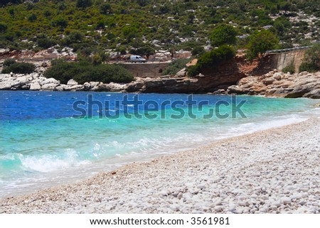 car on a road over the sea - stock photo