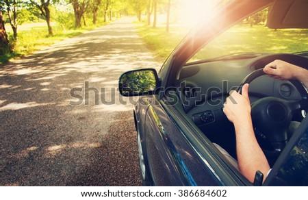 Car on asphalt road in summer - stock photo