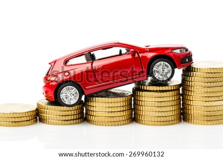 car on coins. symbol photo for costs - stock photo