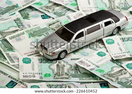 Car on money background - business concept - stock photo