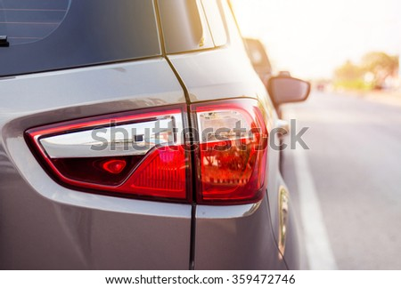 Car on road with sunlight. - stock photo
