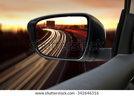 car on the road at night - stock photo