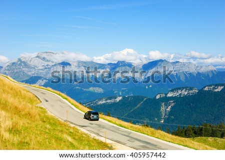Car on the road at the Alps.  - stock photo