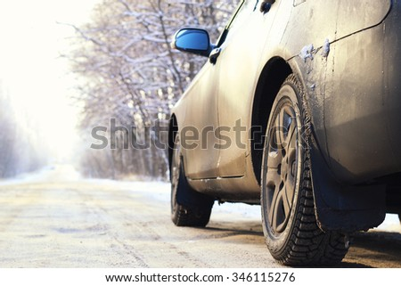 car on the road in winter