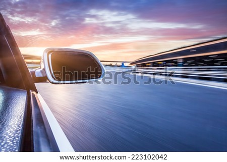 car on the road whit motion blur background - stock photo