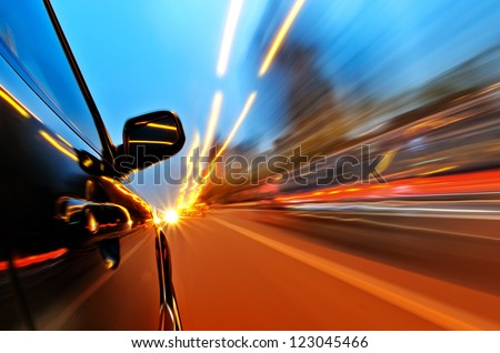 car on the road with motion blur background. - stock photo
