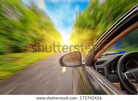 car on the road with motion blur background - stock photo