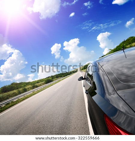 car on the road with the motion blur background - stock photo