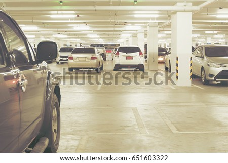 Car Park in Underground Parking Lot at Shopping Center  Soft Focus. Car Park Underground Parking Department Store Stock Photo