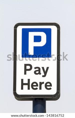 Car park pay sign against a blue sky - stock photo