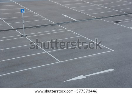 Car park with empty parking lots - stock photo