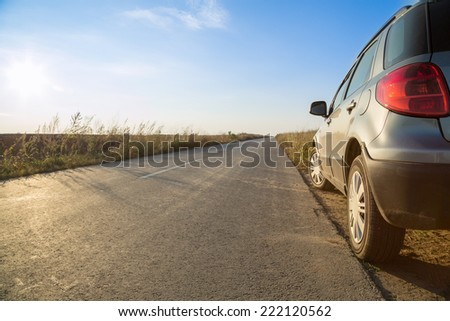 Car parked on a side of road - stock photo