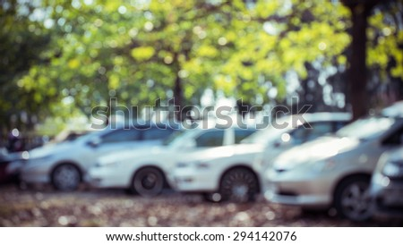 car parking lot with tree green nature, abstract blur background - stock photo