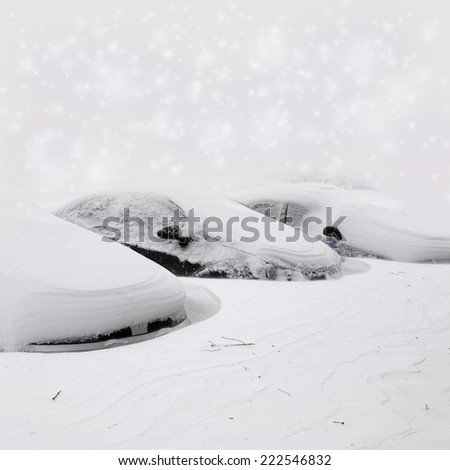 car parking under lot of snow - stock photo