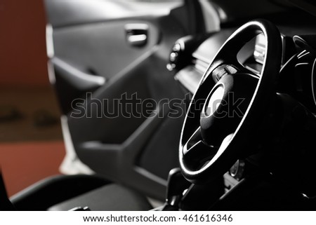 Car photography, close up car control wheel in studio lighting.