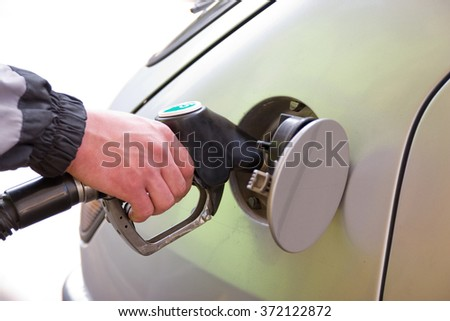 Car refuel at gasoline station