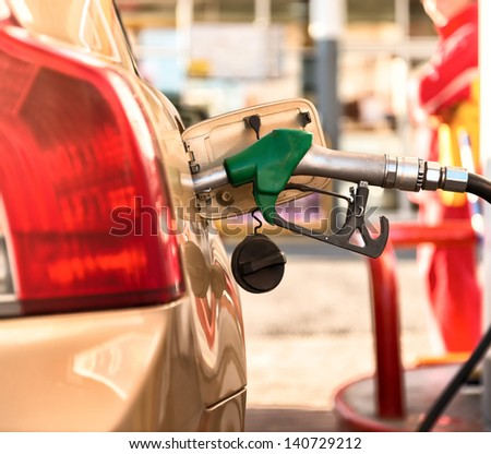 Car refueling on a petrol station . - stock photo
