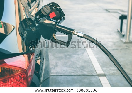 Car refueling on a petrol station. To fill the machine with fuel. Car refueling with gasoline at a gas station. Fuel pump at a station. Close up. - stock photo