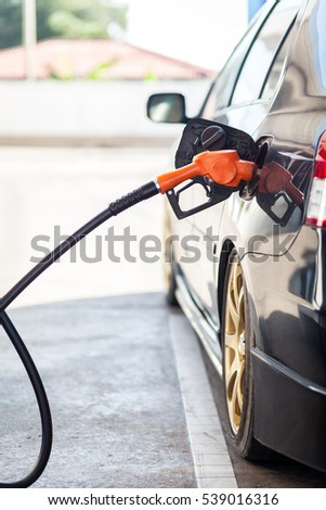 Car refueling on petrol station.
