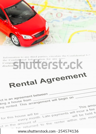 Car rental agreement on map, document is mock-up - stock photo