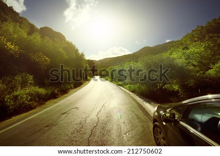 Car ride on road in sunny weather - stock photo