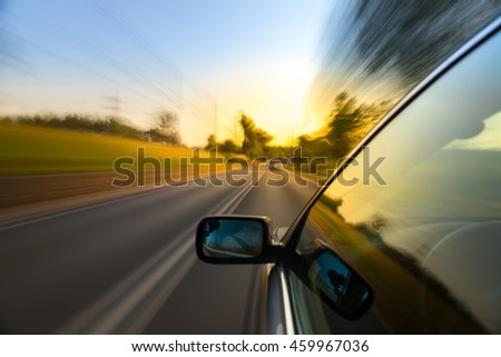 Car ride on road in sunny weather, motion blur