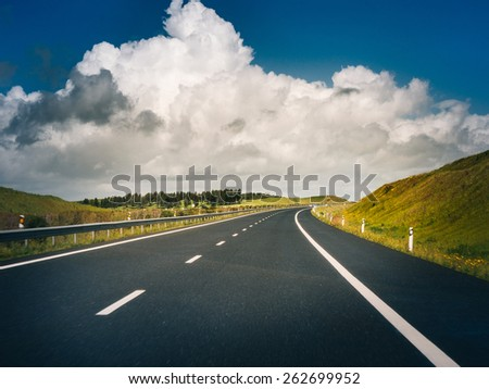 car road under beautiful solar sky - stock photo