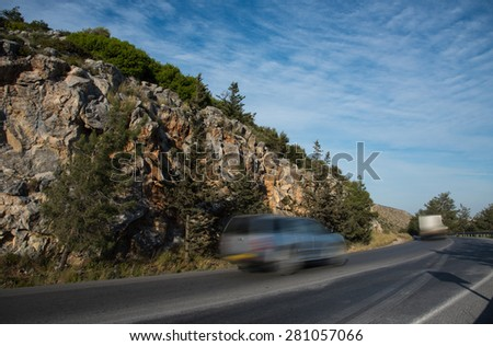 Car running  moving fast on a curved  dangerous  mountain road in the island of Cyprus