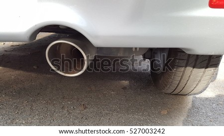 car's rear bumper with exhaust pipe