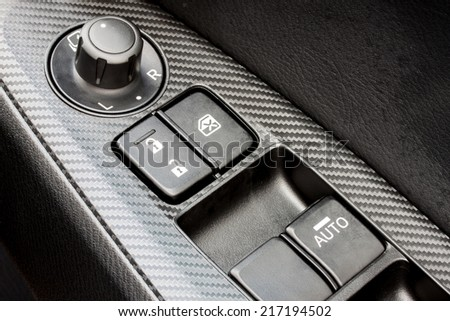 car's window control switch  - stock photo