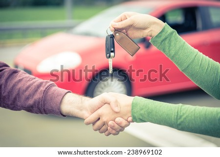 car sales. buyer and seller get to an agreement.  - stock photo