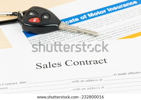 Car sales contract document with key