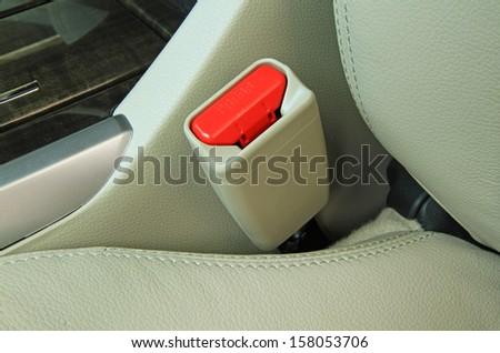 Car seat belt buckle - stock photo