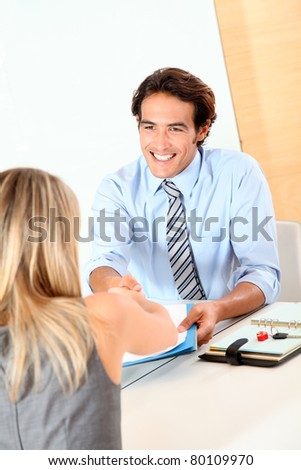 Car seller shaking hand to buyer - stock photo