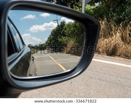 Car side window reflex on the road  - stock photo