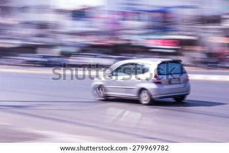 car Speeding in road - stock photo