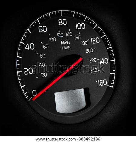 car speedometer on black background - stock photo