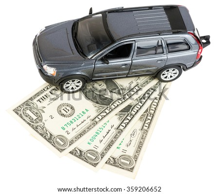 Car standing on dollars