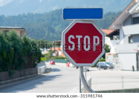 Car stop sign on cityscape background with road