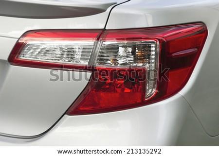 car tail light on a sedan - stock photo