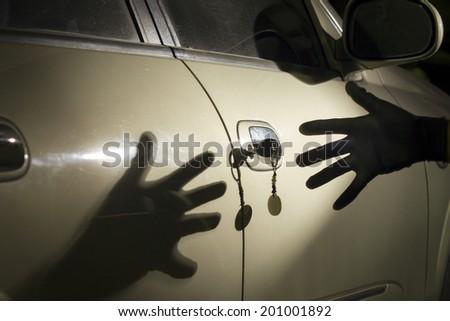 Car thief at parking lot - stock photo