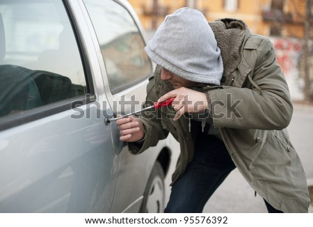 car thief in action - stock photo