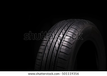 Car tire over black background