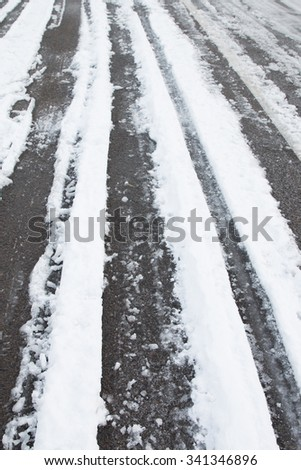 Car tire track in snow