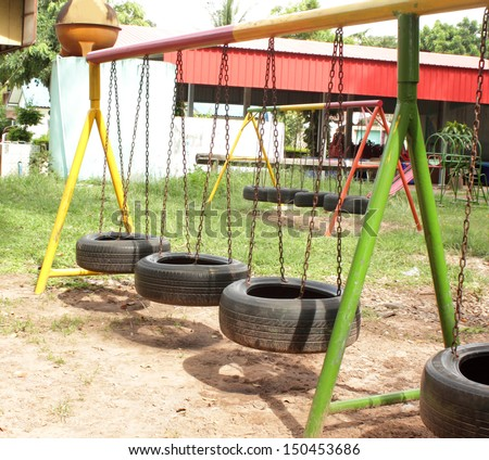 Car tire used as swing - stock photo