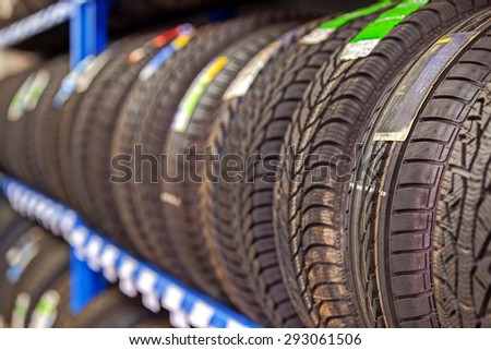 Car tires at warehouse in tire store - stock photo